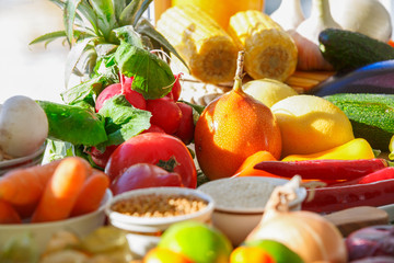 Assorted fruits and vegetables in bright sunlight