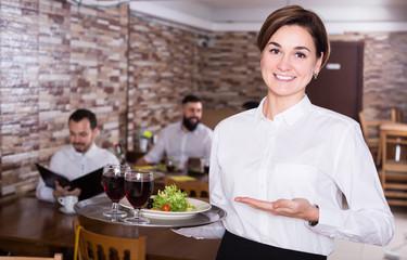 Nice waitress with tray posing