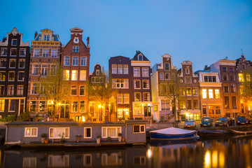 Spoed Fotobehang Amsterdam Night view of Amsterdam cityscape with canal, bridge and houses in the evening
