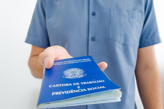 Unemployed worker from Brazil show his work permit document (carteira de trabalho in portuguese) while looking for a job