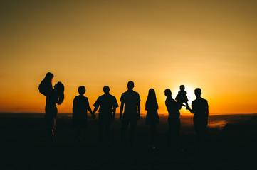 family and beautiful sunset