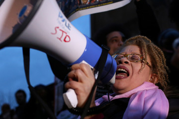 A protester speaks into a bullhorn before a march from Columbus Circle to Times Square in New York City, during a protest against the death of Stephon Clark