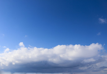 Spring. blue sky with fluffy white clouds. sun, sunlight, clouds, sky - spring changeable weather.