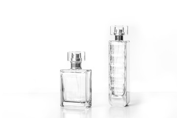 Two perfume bottles isolated on white background, fragrance spray mock up Wall mural