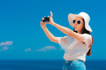 Cute Summer Girl with Sun Hat Taking a Selfie on Vacation