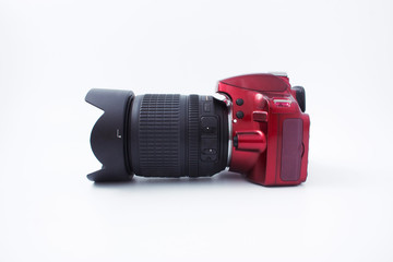 red camera with a lens on a white background