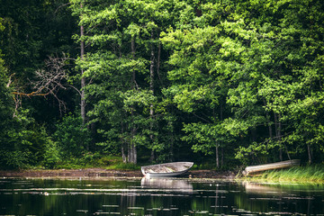 Wooden boat on the shore of a lake