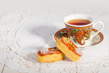 Light Crunchy Puff Layered Pastry Garnished With Pistachios & Coconut Flakes And A Traditional Cup Of Tea Popular Persian Sweets In Iran Called Zaboon Or Zaban