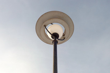 Street lamp round against the sky