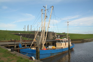 Old fishing boat in the harbor of Termunterzijl. The Netherlands