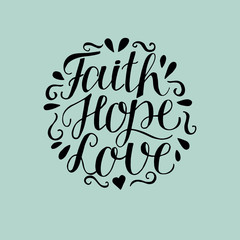 Hand lettering with bible verse Faith, hope and love on blue background.