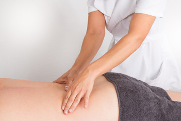 man having massage in spa salon by woman hands