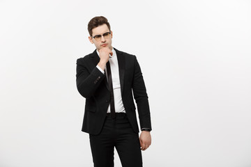Business Concept: Portrait of Thoughtful handsome Businessman wearing smart suit in thinking gesture isolated over white background.