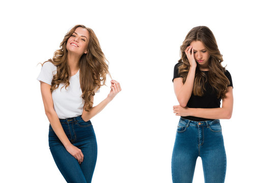 happy and sad twins standing isolated on white