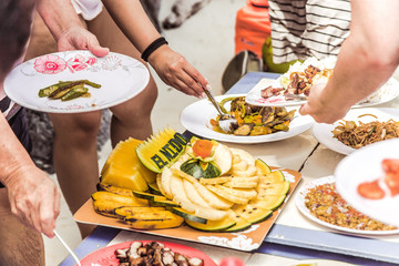 Hungry people are having a lunch with fruit plate with El Nido text cut, Palawan island, Philippines