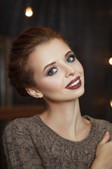 Beautiful model is posing in an interior studio, decorated for Christmas