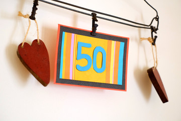 Number 50 anniversary celebration card against a bright white background