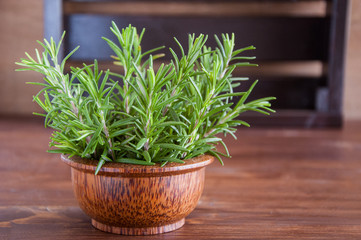 Fresh organic rosemary on a wooden background