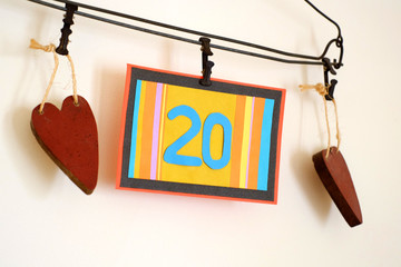 Number 20 anniversary celebration card against a bright white background