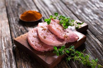 Juicy  pork steaks  on  wooden background