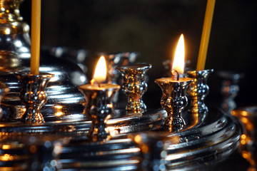 Burning candles in the Church .