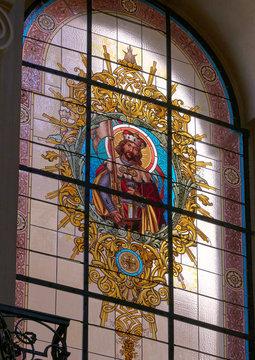 PRAGUE, CZECH REPUBLIC - MAY 16, 2017: Tained glass window at Church of St. Ignatius at Karlovo namestí, Charles square. Prague, Czech Republic, Europe