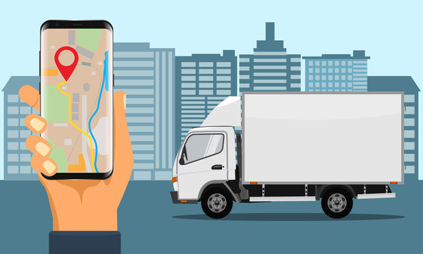 Hand holding smartphone for tracking delivery. City skyline and truck.