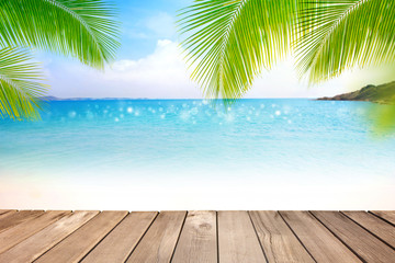 Wooden table with blurred sea,blue sky and palm tree background-Template mock up design for product display or montage your product. Summer holiday traveling concept.