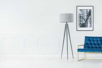 Tripod lamp in minimalist interior