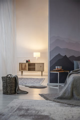 Illuminated bedroom with mountains wallpaper