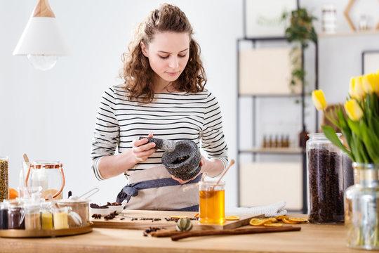 Girl grinding herbs