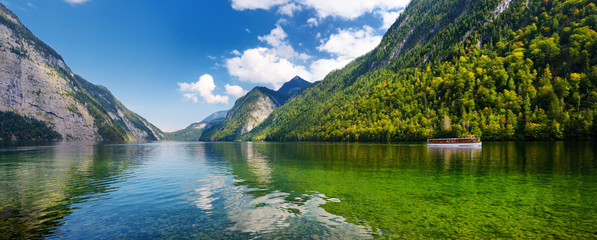Stunning deep green waters of Konigssee, known as Germany's deepest and cleanest lake, located in the extreme southeast Berchtesgadener Land district of Bavaria. Wall mural
