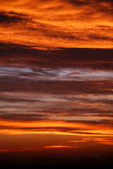 amazing sunset wallpaper. beautiful red sunset and clouds in orange sky, dramatic view. fascinating image. beautiful nature moments, breathtaking scenery. vertical pattern