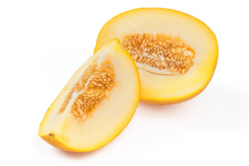 Slices sweet yellow melon with seeds. Close-up on white background