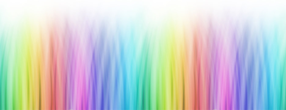 Rainbow Background Banner - wide banner of bright linear rainbow colour fading to white