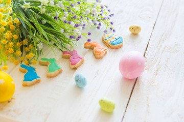 Colorful easter cookies on a white wooden background. Happy Easter concept