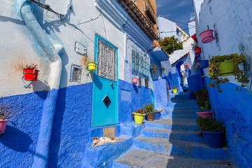 Blue street with color pots in Chefchaouen