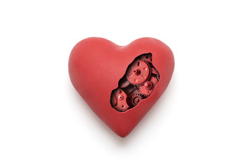 Red mechanical heart over white background with clipping path