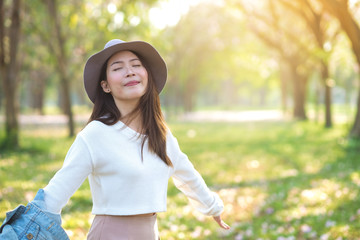 Young woman enjoying spring day in morning