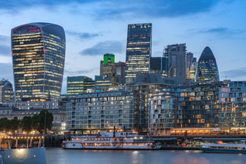 Thames embankment and london skyscrapers in City of London after sunset