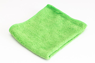 Green folded microfiber cloth on white background