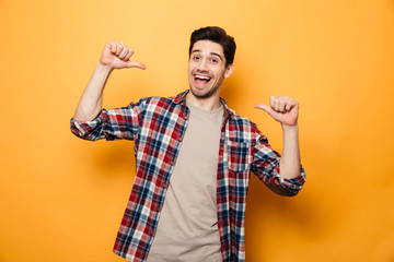 Portrait of a confident young man pointing fingers