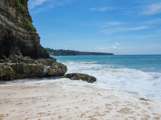 Azure beach with clear water of Indian ocean at sunny day A view of a cliff in Bali, Indonesia