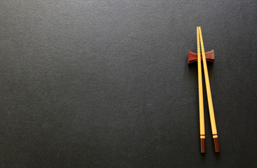Wooden Chopsticks on black table.Copy space,Flat lay
