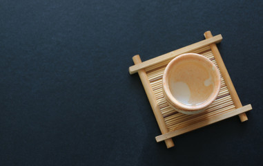sake japanese in cup oriental drink style on black table.Top view with copy space