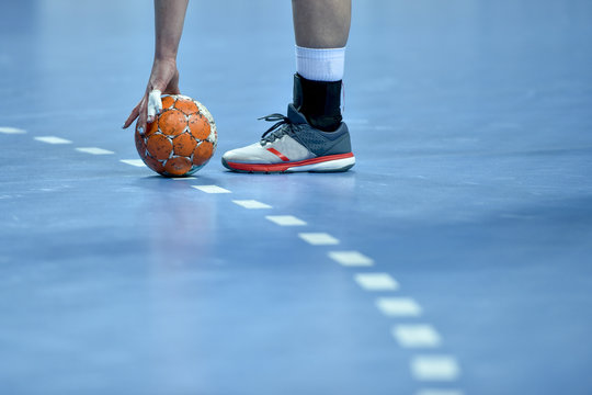 handball ball laying on the 9 meters dotted line on the pitch