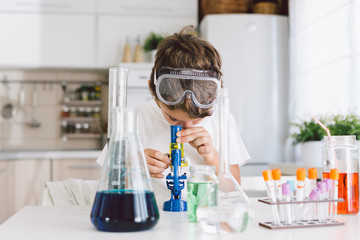 Boy doing some science, playing in the kitchen