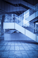 A staircase with a blue background