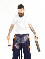 Man with beard in dirty dusty boilersuit. Builder, plasterer, repairman