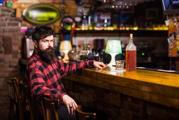 Guy spend leisure in bar, defocused background.